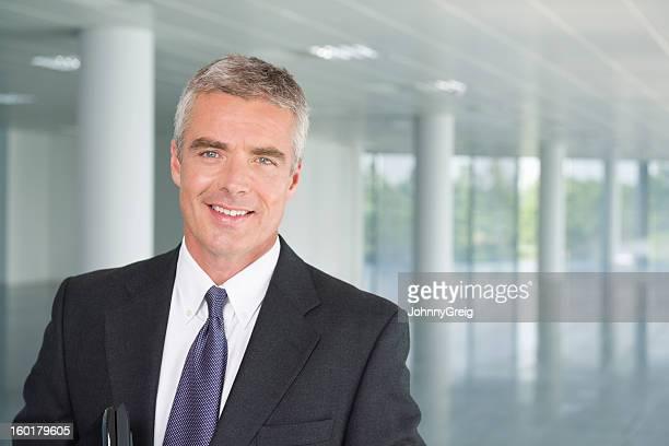 Mature Businessman In Suit Smiling