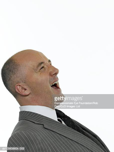 Mature businessman, laughing, close-up