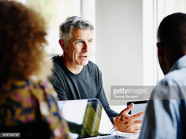 Mature businessman leading project discussion