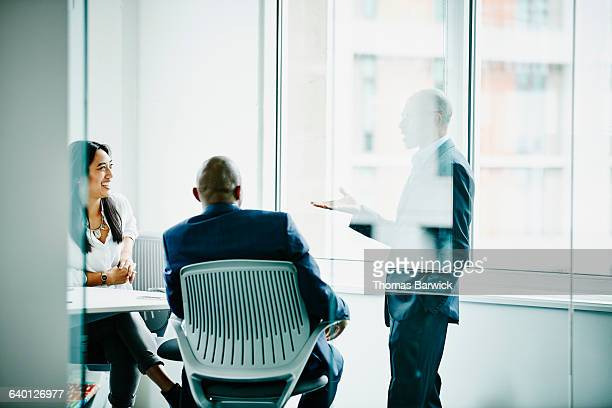 Mature businessman leading team meeting in office