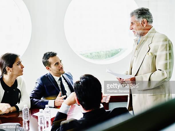 Mature businessman leading team meeting