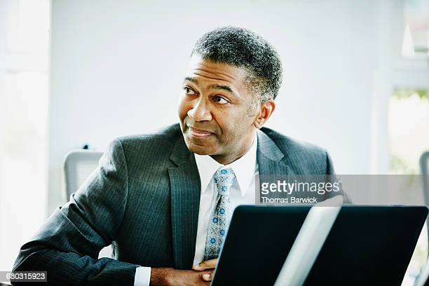 Mature businessman listening during meeting
