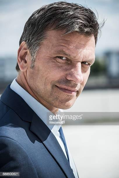 Mature businessman looking at camera, portrait