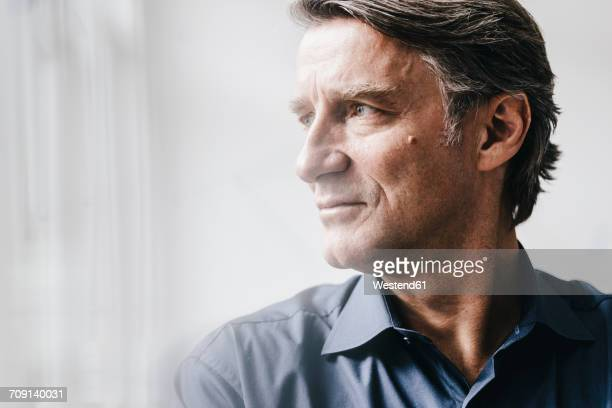 Mature businessman looking away