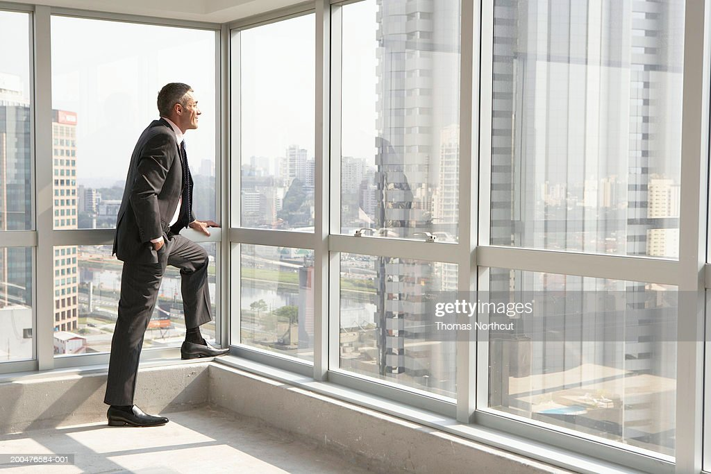 Mature Businessman Looking Out Office Window Side View Stock Photo | Getty  Images