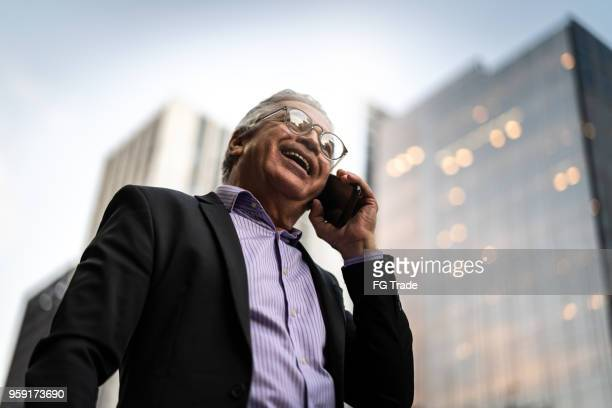 mature businessman on a rush hour in a city - brazilian men stock photos and pictures