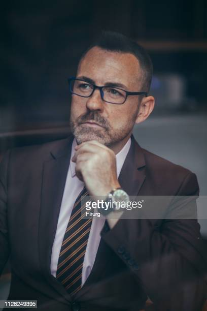 mature businessman portrait - chin stock pictures, royalty-free photos & images