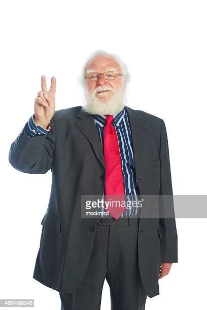 Mature Homme d'affaires montrant le signe de la victoire