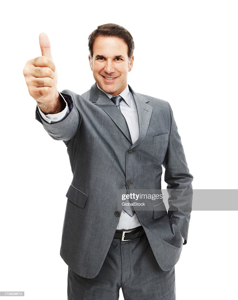 Mature businessman showing thumbs up sign : Stock Photo