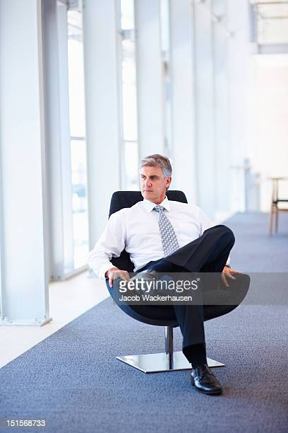 Mature businessman sitting on office chair