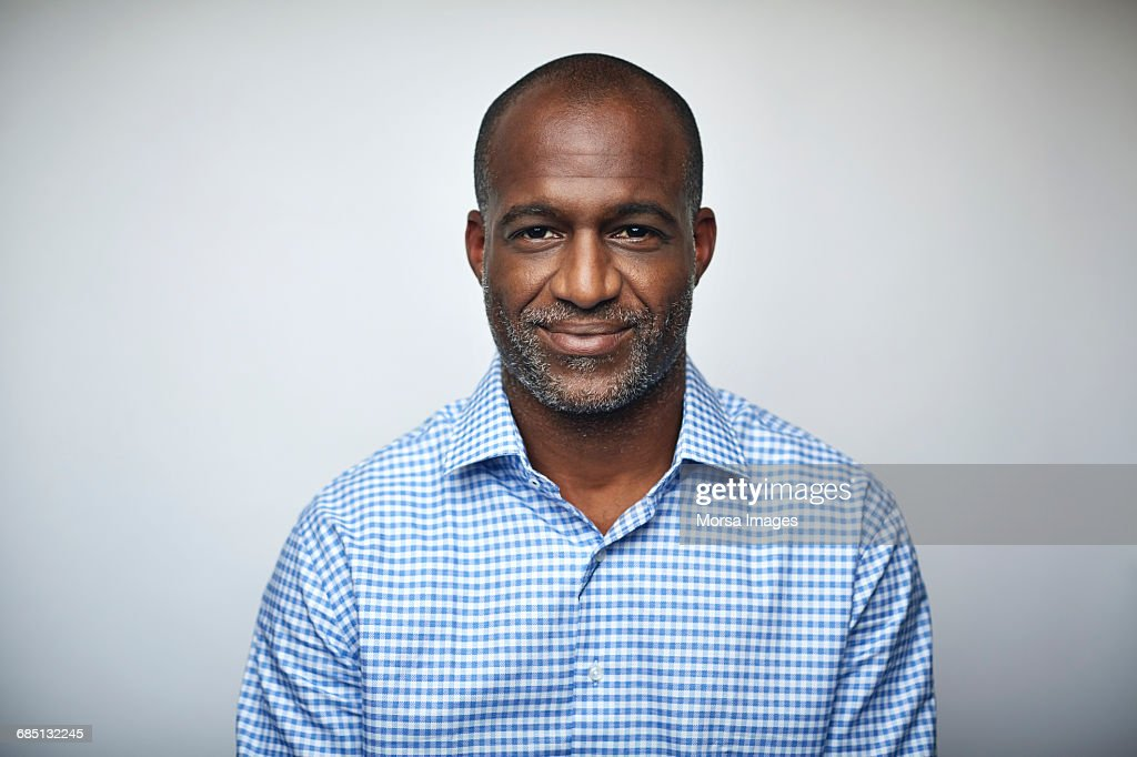Mature businessman smiling over white background : Stock Photo
