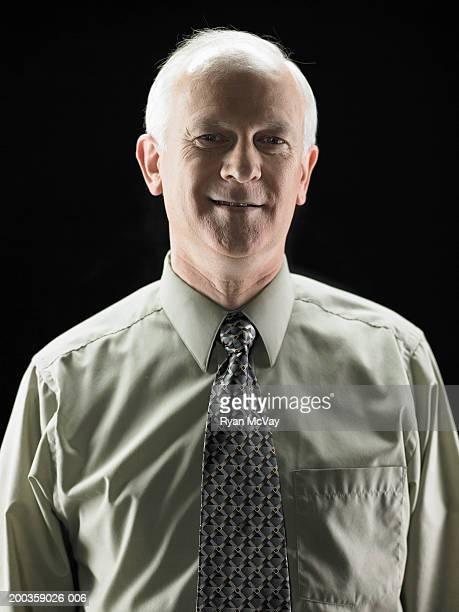 Mature businessman smiling, portrait