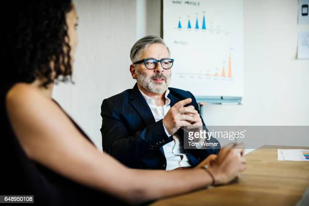 Mature businessman speaking during a meeting