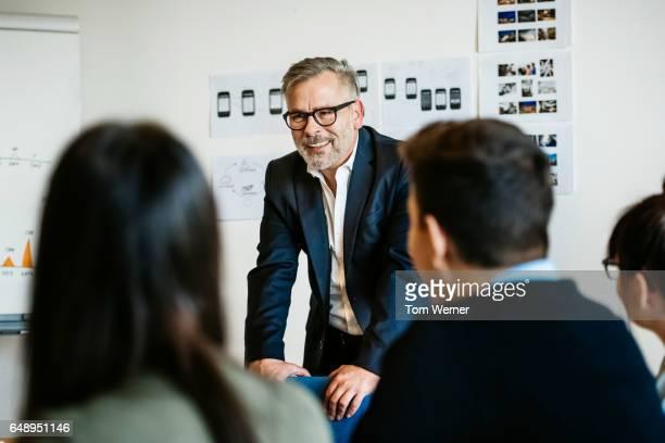 Mature businessman speaking in an informal meeting