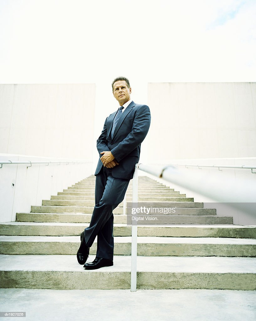 Mature Businessman Standing at the Bottom of Steps : Stock Photo