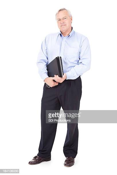 Mature Businessman Standing Holding Laptop