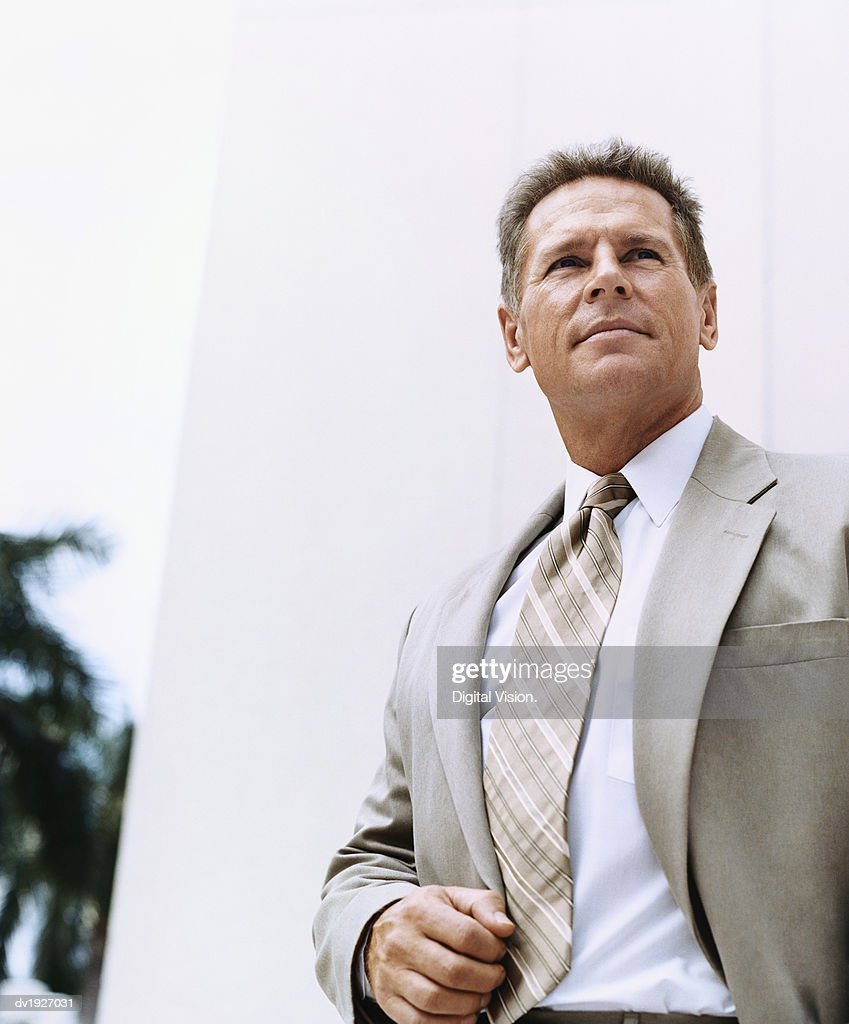 Mature Businessman Standing Outside a Building : Stock Photo