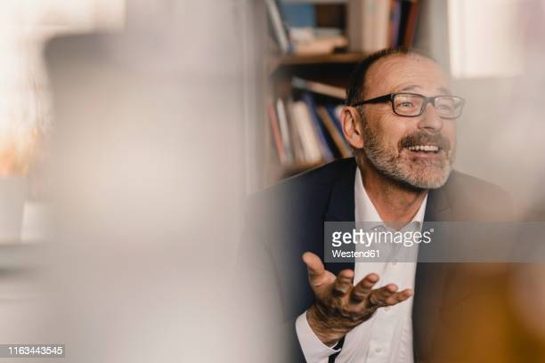 mature businessman talking in a cafe - gesturing stock pictures, royalty-free photos & images