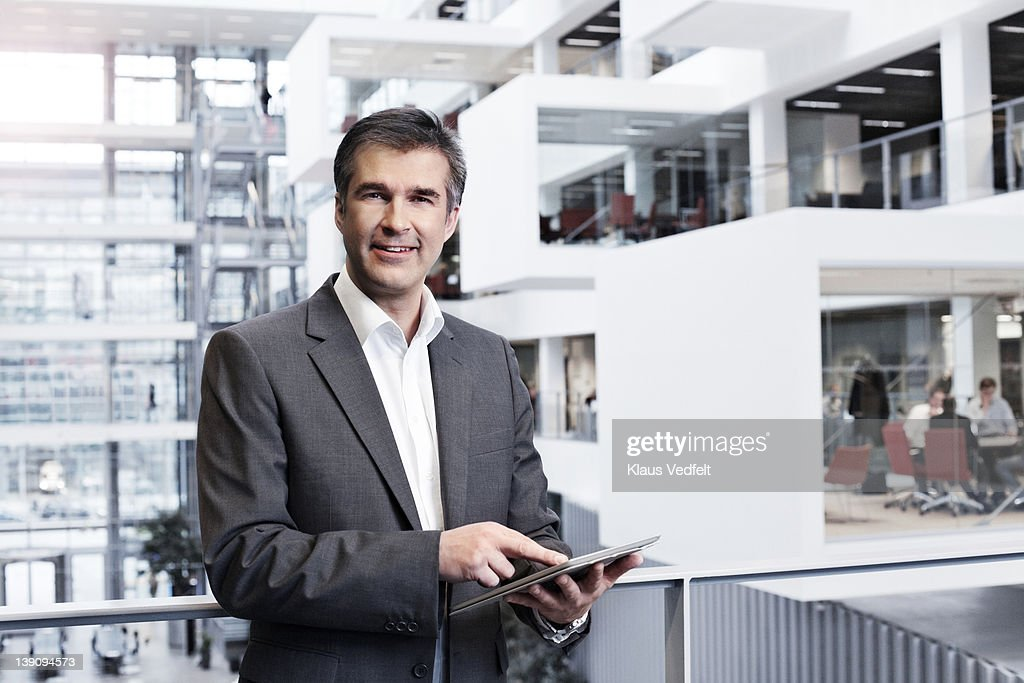 Mature businessman using tablet : Stock Photo