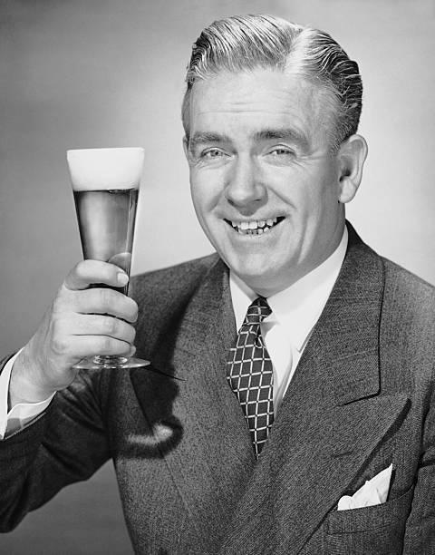 Mature businessman w/ beer