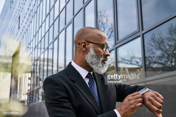 Mature businessman wearing smartwatch