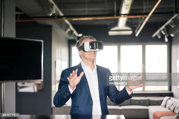mature businessman wearing vr glasses - insight tv ストックフォトと画像