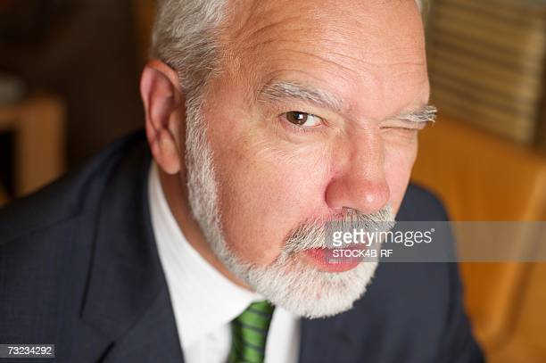 Mature businessman winking