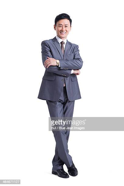 Mature businessman with arms crossed