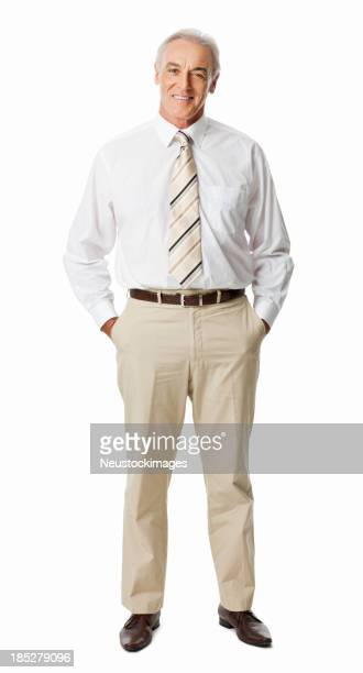 Mature Businessman With Hands In Pockets - Isolated