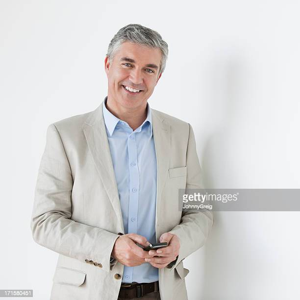 Mature Businessman With Mobile Phone