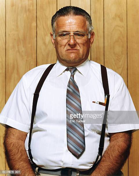 Mature businessman with pencil and cigars in shirt pocket