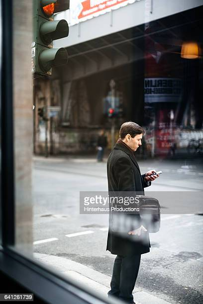 Mature Businessman With Smart Phone On the Street