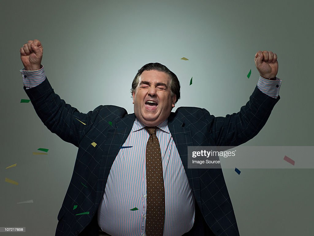 Mature businessman with ticker tape, portrait : Stock Photo