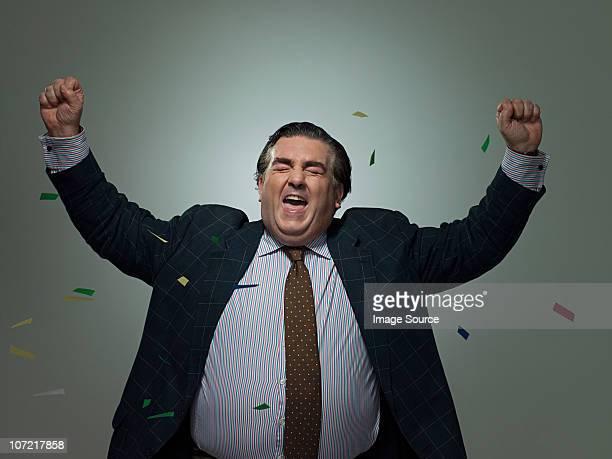 Mature businessman with ticker tape, portrait