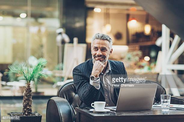 Mature businessman working in comfort