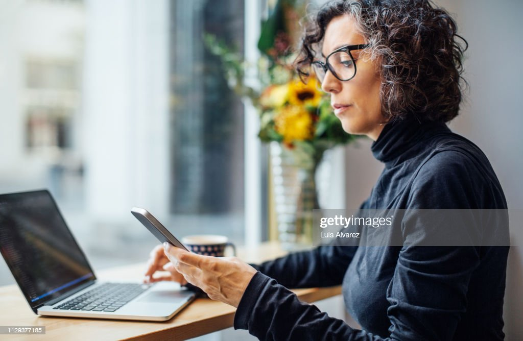 Mature businesswoman at cafe : Stock Photo