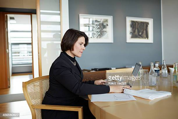 Mature businesswoman doing 'Working Lunch'