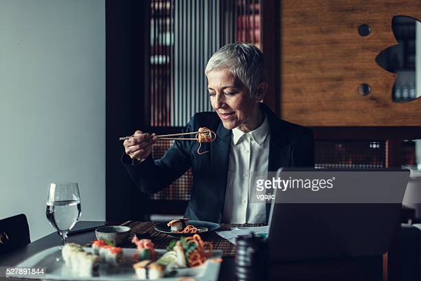 Mature Businesswoman Having Lunch