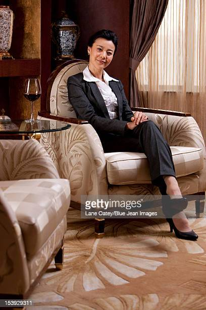 Mature businesswoman in a luxurious room
