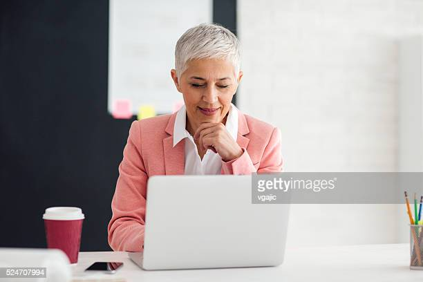 Mature Businesswoman In Her Office.