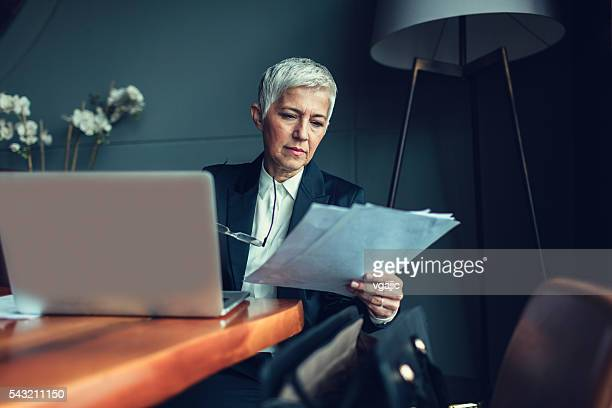 mature businesswoman in her office. - image technique stock pictures, royalty-free photos & images