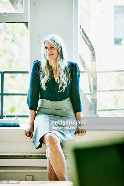 Mature businesswoman in meeting with colleagues