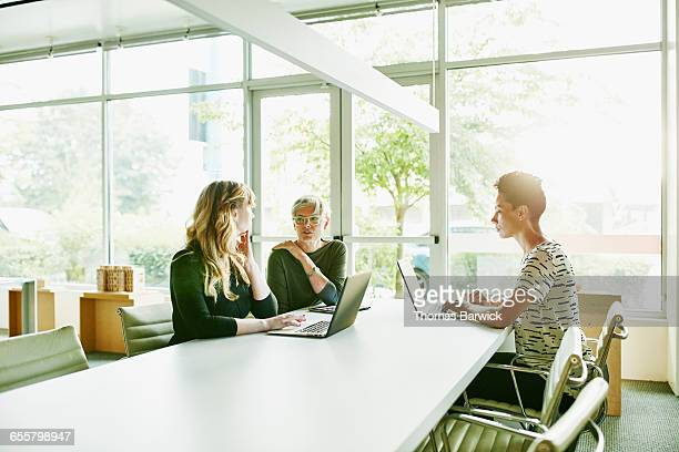Mature businesswoman leading discussion in office