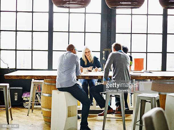 mature businesswoman leading project meeting - leanintogether stock pictures, royalty-free photos & images