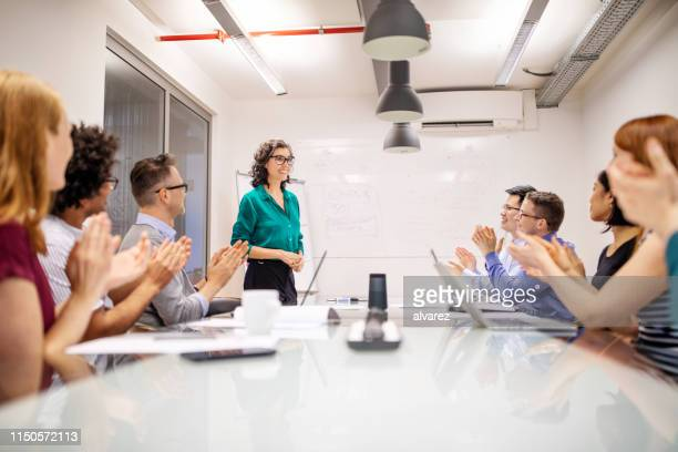 mature businesswoman making a successful presentation - applauding stock pictures, royalty-free photos & images