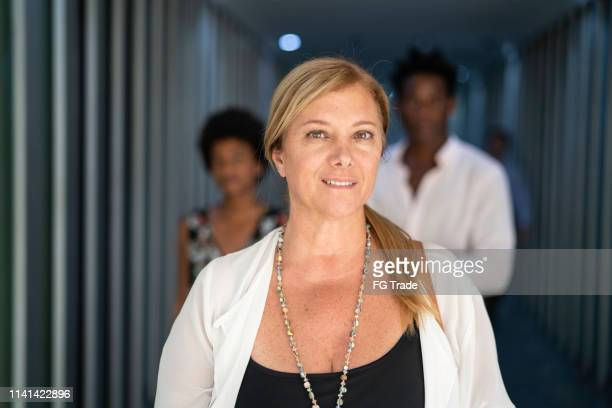 mature businesswoman portrait on the city - vanity stock pictures, royalty-free photos & images