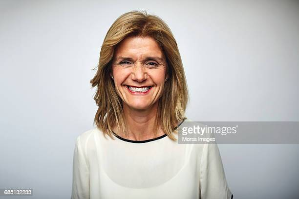 Mature businesswoman smiling over white background
