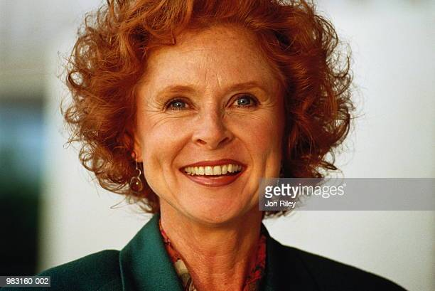 mature businesswoman smiling, portrait - northern european descent stock pictures, royalty-free photos & images