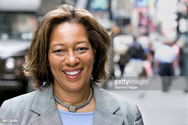 Mature Businesswoman Standing on City Sidewalk