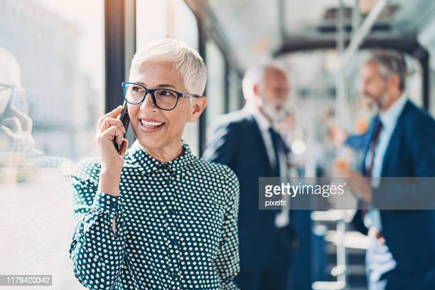 mature businesswoman talking on the phone - white hair stock pictures, royalty-free photos & images